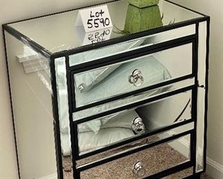 Lot 5590.  $235.00.  Matched pair of mirrored 3 drawer side chests.  Chrome hardware includes an artificial plant as shown on top.