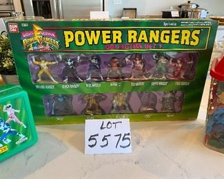 Lot 5575 $45.00. Container of mixed animals, dinosaurs, Indians and cowboys, Power Rangers Storage Box, and Power Rangers Collector Set One.  May be missing a ranger or two.