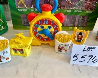 """Lot 5576. $18.00. Playskool Stop N Go Wind-up Clock (works!), McDonald's Flintstones Meal Toy, """"Roc Donald's Building Accessory c.1993, 2 Burger King French Fry Squirters, Burger King French Fry Jumper."""