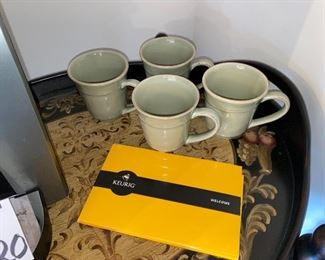 Lot 5520. $65.00.  Keurig Machine, a glass canister (perfect for storing K-Cups or beans), and 4 Pottery Barn Mugs.