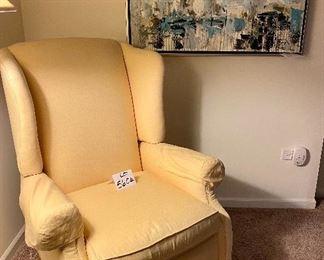 Lot 5604.$150.00  Hearthside Classics Recliner, in Yellow.  Pretty recliner in a bedroom.
