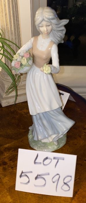 """Lot 5598  $40.00. Tengra Girl Figurine holding a basket of flowers.  11""""x5""""w. Tengra is a similar manufacturer to Lladro - made in Spain; it's all in the clay."""