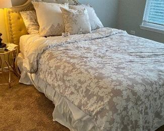 Lot 5615. $425.00. Queen Bed, With Nailhead and Fabric Headboard, Ralph Lauren premier mattress pad, comforter (Duvet?), 4 pillows and shams (2 are Euro) pillowtop mattress by Beauty Rest Wilshire Plus comfortable.