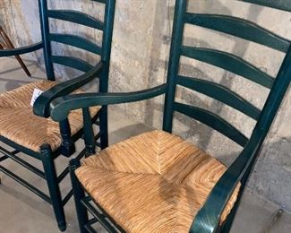 Lot 5643A. $40.00. A pair of pretty forest green ladderback chairs with Rush Seats