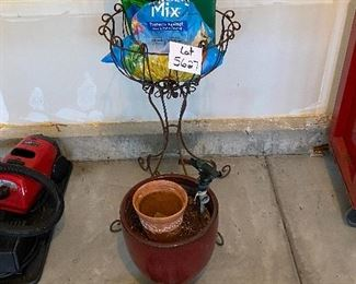 Lot 5627  $45.00  Garden Special (Spring Please Arrive Early!) includes: Wrought Iron Plant Stand; Large Brown Ceramic Pot, 2 Green Knee Pads, Nozzle and 2 Sprinklers, another terra cotta smaller pot