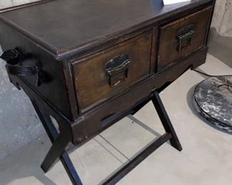 Lot 5646. $38.00. 2- Drawer Cabinet sits on Luggage Rack - wood with 2 leather handles.