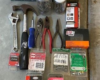 Lot 5634  $20.00 Tools and Hardware Lot includes: Hammer, Wrench, Pliers and lots of nails, screws and fasteners