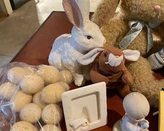 Lot 5653. $35.00. Easter Bunny Lot:  Includes 3 Plush Bunnies (may be Vintage; cute), One Bunny Candle Holder, Chalkware White Bunny, 3 Easter frames, 1 Prec. Moments Boy Holding egg, 1 Bunny Porcelain Bell andf 16 Speckled Eggs. (Use for Centerpiece with Faux Grass and a Basket.