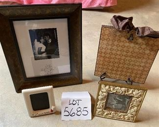 """Lot 5685 $25.00 Picture Frame Lot 1: 1) 8""""x10"""" wood embossed picture frame 2) 9"""" x 9"""" Clip Picture Frame with Bow on Top"""