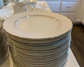 """Lot 5602. $170.00. Service for at least 12 """"Grace"""" Fine China """"Concerto"""" pattern - Textured Rim, White with a Simple Ring of Silver on base and Rim.  43 pcs-- 14 Dinner, 12 Salad, 14 B&B, Large Oval Platter, Round Veggie Dish & Creamer.  I think when they moved one box was lost, in the move so there are no cups and saucers nor a sugar bowl!  Still, you can set a beautiful table with these items in time for Easter Sunday!"""