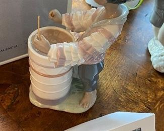 """Lot 5596. $125.00. Lladro #06277 """"Caribbean Rhythm"""" made exclusively for """"Little Switzerland""""  8"""" tall, x 4"""" deep. Young Man Banging on Drums!"""