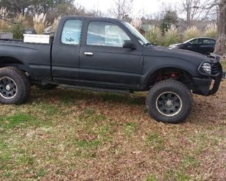 1997 Toyota Tacoma. 6 cylinder with wencj and cattle guard.