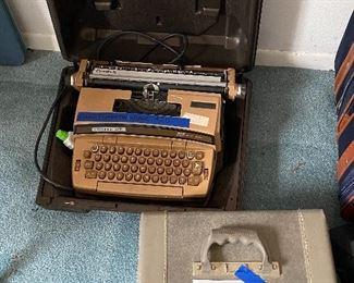 Smith Corona electric typewriter and vintage suitcase
