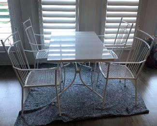 "METAL OUTDOOR TABLE & 4 CHAIRS.                               47.25"" X 29.5""                                                                             GOOD CONDITION."
