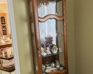 Lighted curio cabinet filled w/collectibles