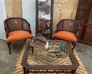 Vintage bamboo trimmed table, cool chairs and tiger rug.