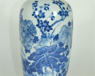 18/19TH CENTURY Blue and white vase with slender upright body tapering towards the base,the domed shoulders with a short waisted neck.Poems with flowers.  Used Condition: One Hairline on the rim,otherwise in Good condition,as photos. Measures:23.5cm Height ;