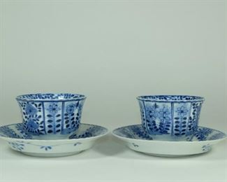 """Description 18TH CENTURY A pair of teacup saucers, painted flowers,the slightly rounded,petal-lobed sides rising from a flat base to the petal type rim.Four-character """"Kangxi Nianzhi"""" marks and Peirod.  Used Condition:Good condition,as photos. Measures:Dishes:13.4cm by 2.6cm height; Cups:8.5cm by 5.7cm height."""