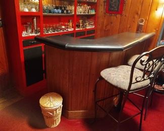 Awesome vintage bar with black formica top, black vinyl padded arm rest, solid wood construction, two pieces for easy moving