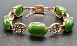 """Women's Asian Inspired 14K Jade Bracelet. Beautiful bracelet has a light scuff on one of the stones, but in otherwise excellent condition. measures about 7"""" around."""
