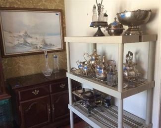 plenty of silverplate and bar that opens