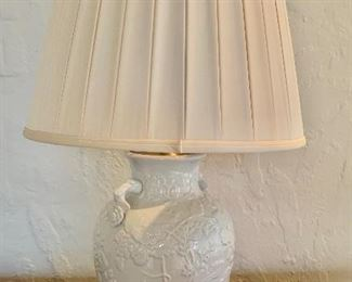 """$225 - Blanc de chine ceramic lamp with flower motif and hand made box pleat silk shade. Tested and working. 26""""H x 16.5""""D"""