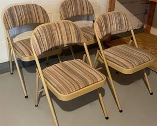 REDUCED!  $22.50 NOW, WAS $30.00......................Set of 4 Padded Folding Chairs, One chair has a small burn stain (H247)