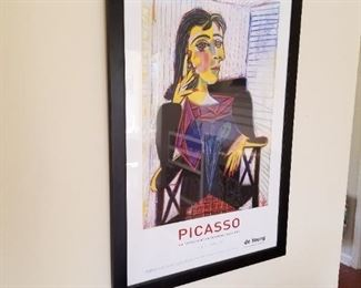 Picasso print is one of many art items.