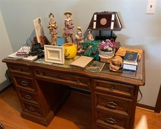 . . . a nice office desk with lots of treasures on it.