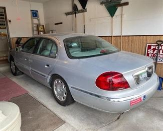 . . . 1999 Lincoln Continental with only 80,000 miles and in excellent condition!! Yes -- driven by a little old lady.