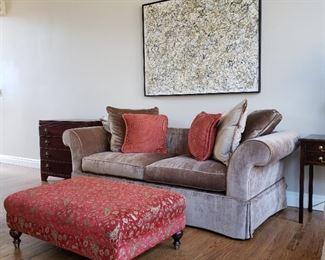 Champagne color velvet sofa and upholstered ottoman