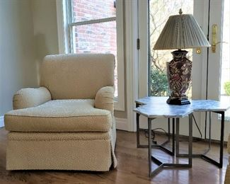 One of a pair of Sherrill Furniture Co. upholstered armchairs and a set of three marble top metal base octagon tables