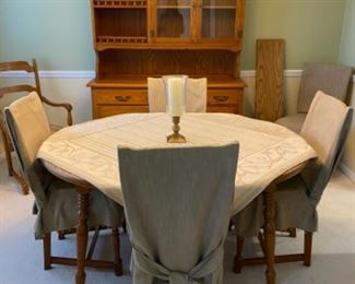 Dining room table & chairs include slip cover