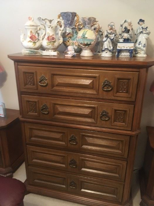 . . . a chest of drawers -- part of a four-piece bedroom set.