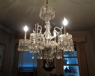 Antique crystal chandelier in dining room