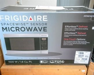 """Brand new """"white"""" microwave (also have matching trim kit)"""