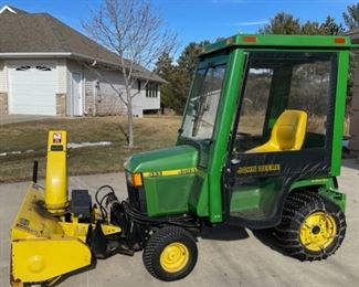 """1999 445 John Deere Tractor includes Cab, 46"""" Snow Thrower,  54"""" Dirt Blade, 54"""" Mowing Deck, Lift Mechanism, 6 Weights and Chains. Pamphlets on all included(S018)"""