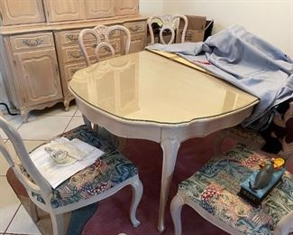 Dining room table with custom made glass top & extra leaves