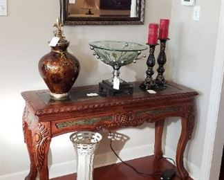 Library table, mirror, urn, candlesticks