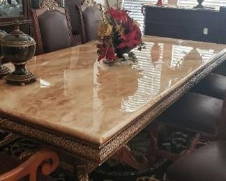 Marble top rectangular dining table, area rug