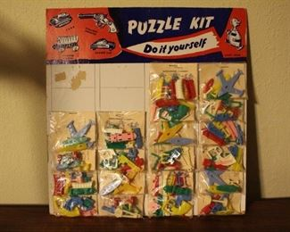 Plastic keychain puzzles on card