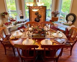 Table chairs dishes and décor