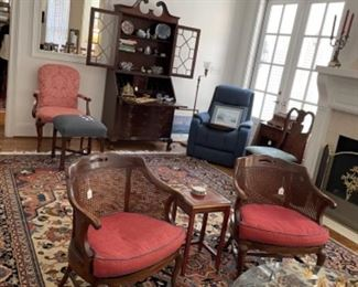 FABULOUS RUG IN LIVING ROOM OFF KITCHEN.  BEAUTIFUL CANE BACK CHAIRS.