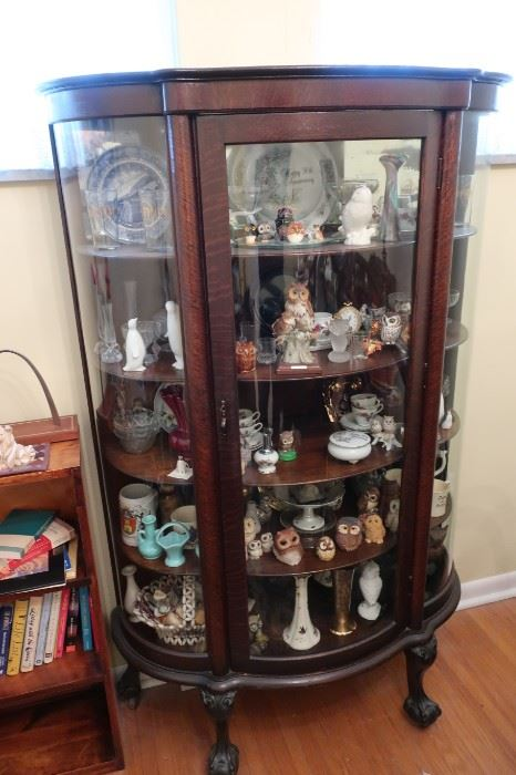 """vintage oak curio cabinet 61"""" tall x 54"""" wide, 395.00 and can be purchased prior to the sale"""