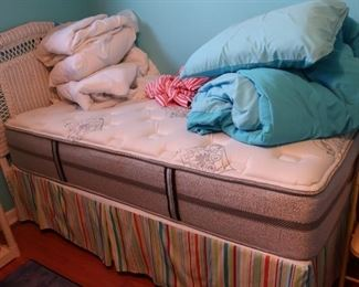NIce  twin  bed  with  wicker  headboard       125.00  It  can  be  purchased  before  the  sale.  (  mattress  is  sold)  Headboard  is  still  for  sale