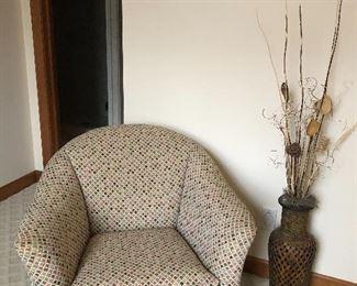 Swivel club chair and rattan vase