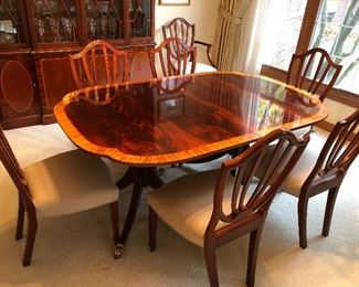 Baker dining table (2 leaves) with pads and 8 chairs (2 arm and 6 side - Shield Back style)