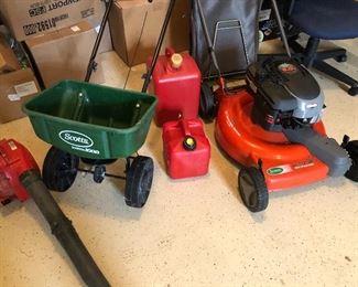 fertilizer spreader, leaf blower, and mulching mower