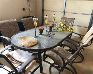 Oval patio table with 6 swivel and rocking armchairs