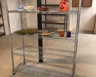 Rolling racks and metal and wood shelving